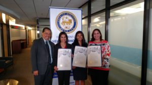 Representatives from NALEO Educational Fund and Neighborhood Centers, Inc. receive the Citizenship Day proclamation